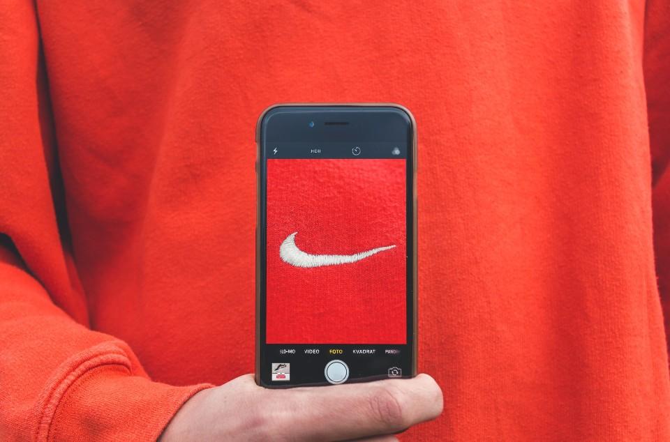Nike logo as shown through a phone screen