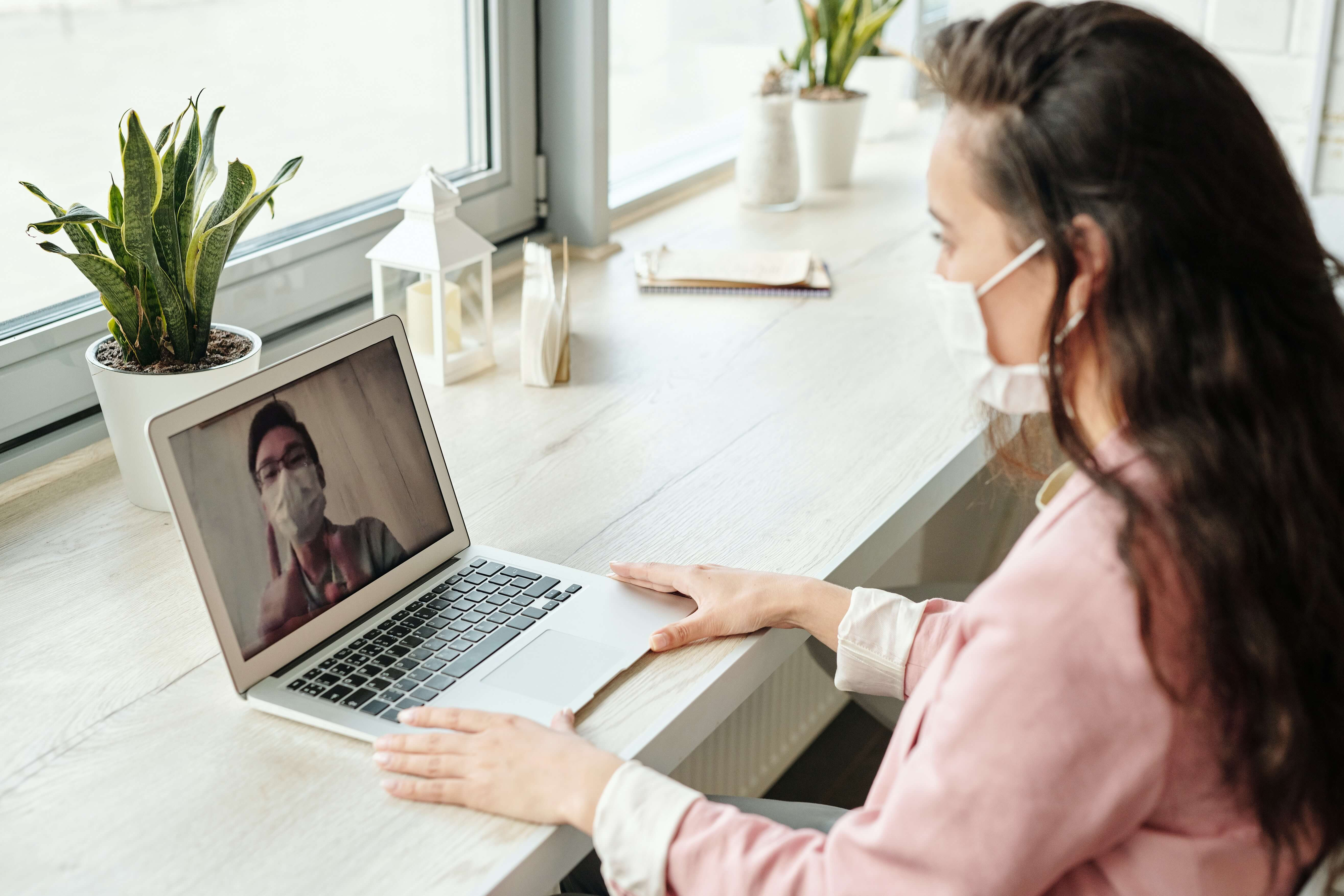 Woman consulting with doctor online